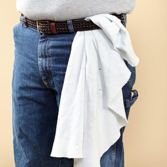 Wearing a rag for constant access to an easy clean up utensil | Construction Pro Tips