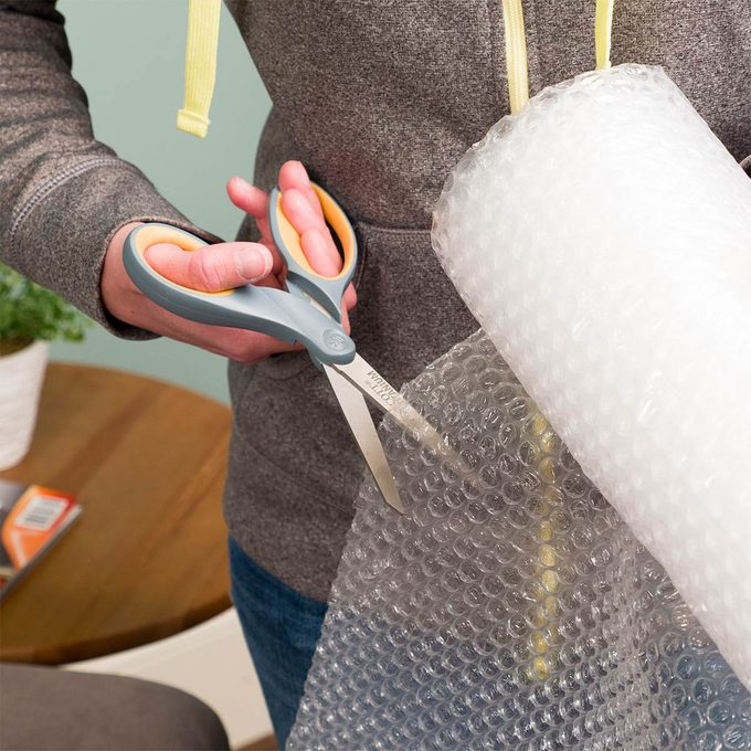 cutting a piece of bubble wrap