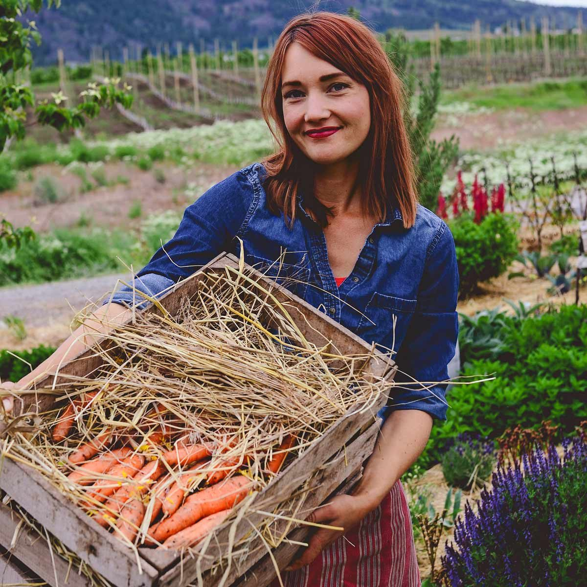 rootcellar_10 farming fresh carrots woman farmer