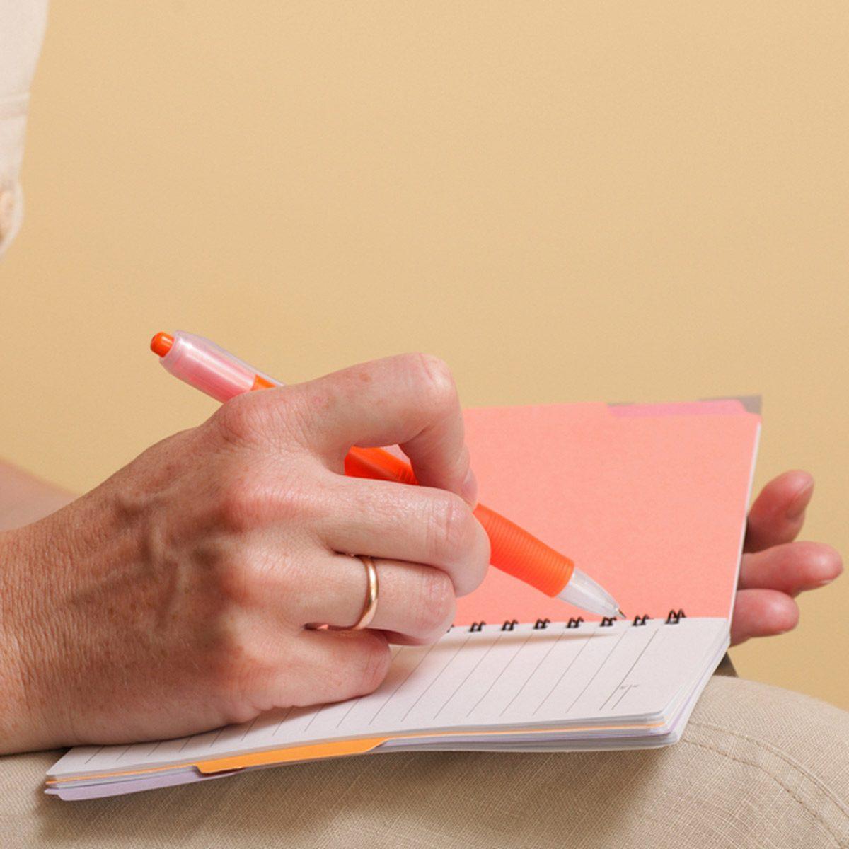shutterstock_74076406 notebook writing