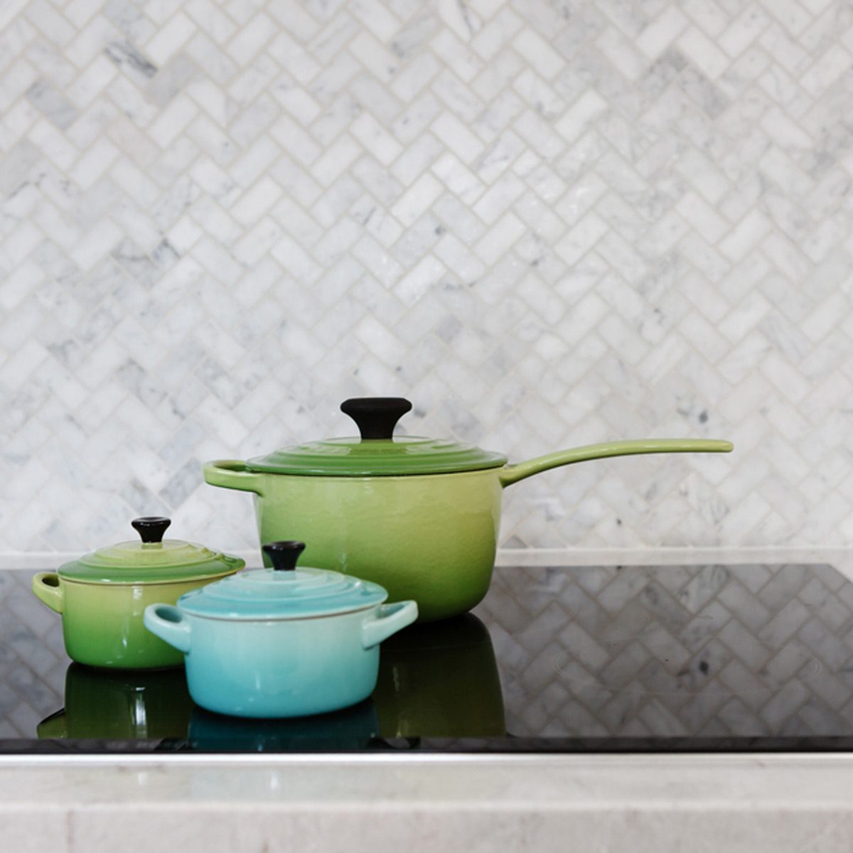 shutterstock_758302198 grey tile kitchen backsplash pots
