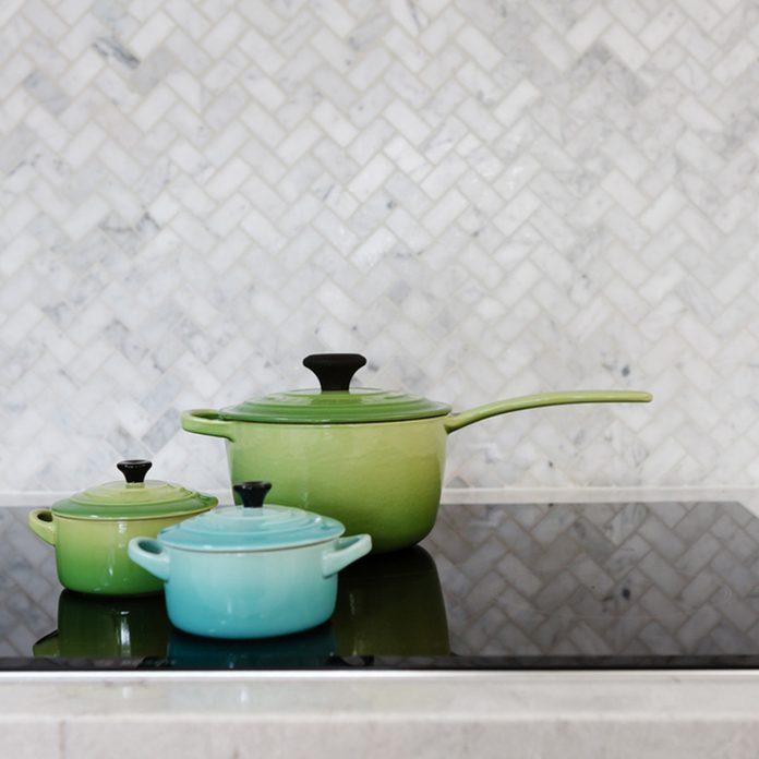 shutterstock_758302198 grey tile kitchen backsplash pots