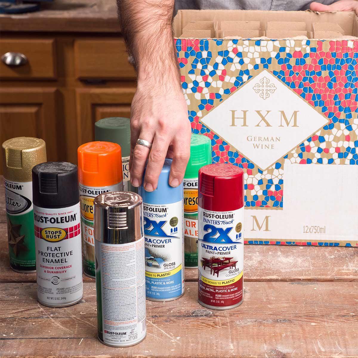 putting spray paint in wine box
