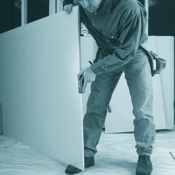 A Man Planing Drywall | Construction Pro Tips