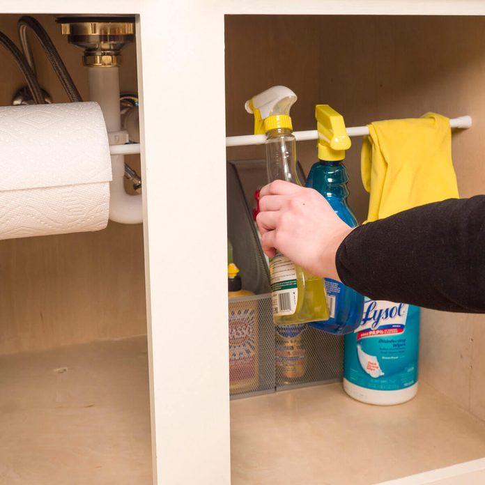 laundry room ideas Tension rod organize under sink