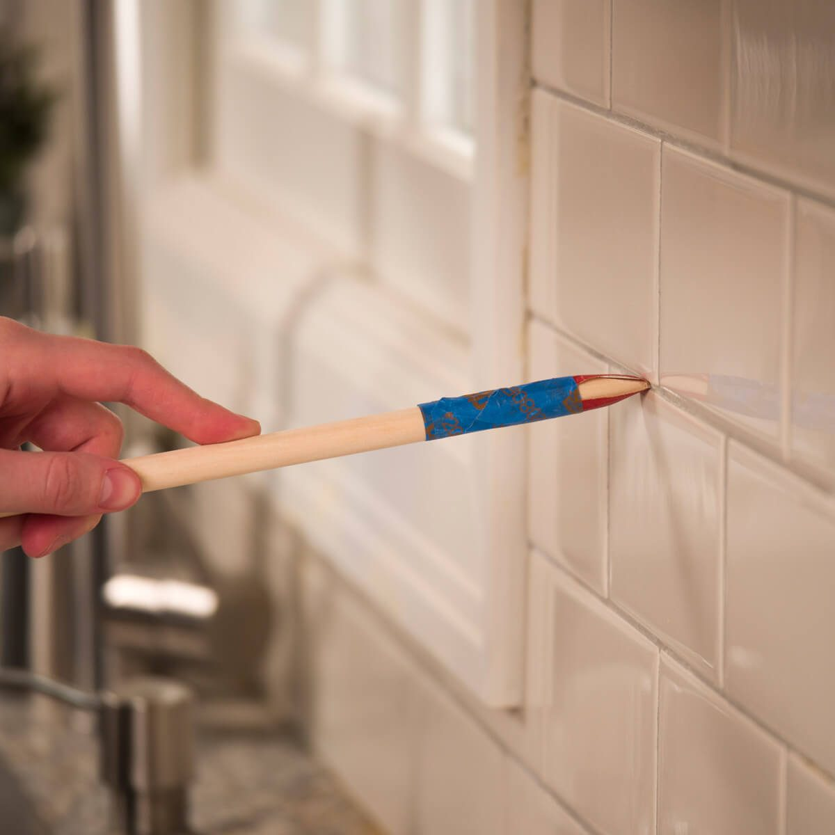 HH Clean tile grout with sandpaper dowel