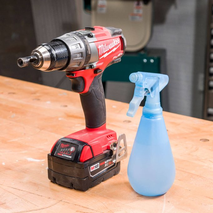 HH drilling into glass spray bottle