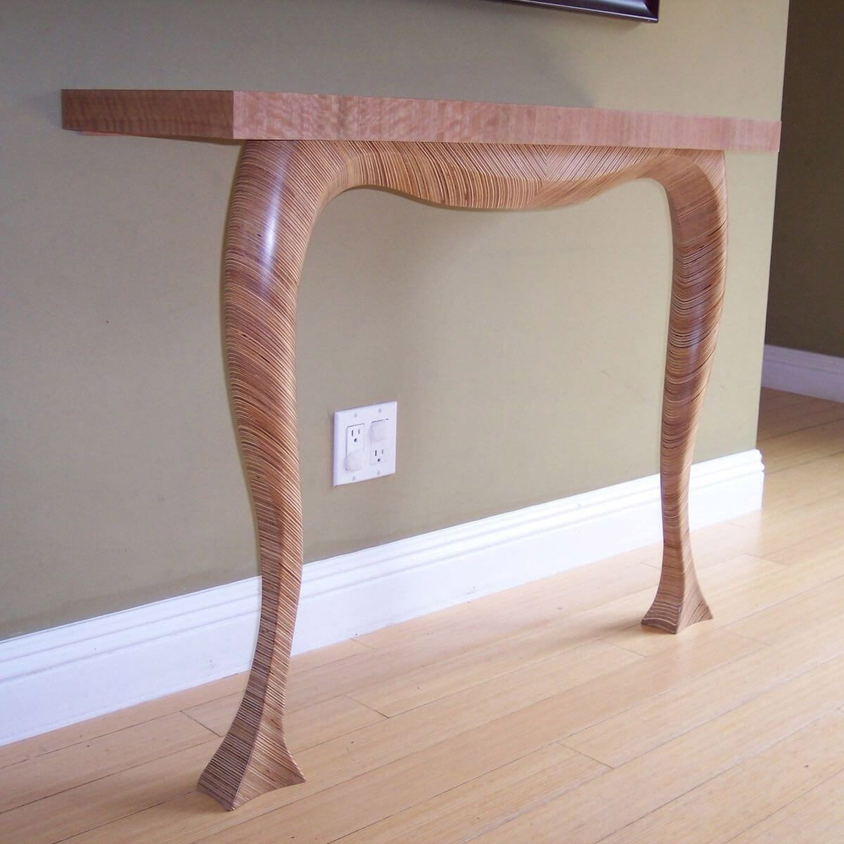Modern Table Sculpted from Scraps of Plywood