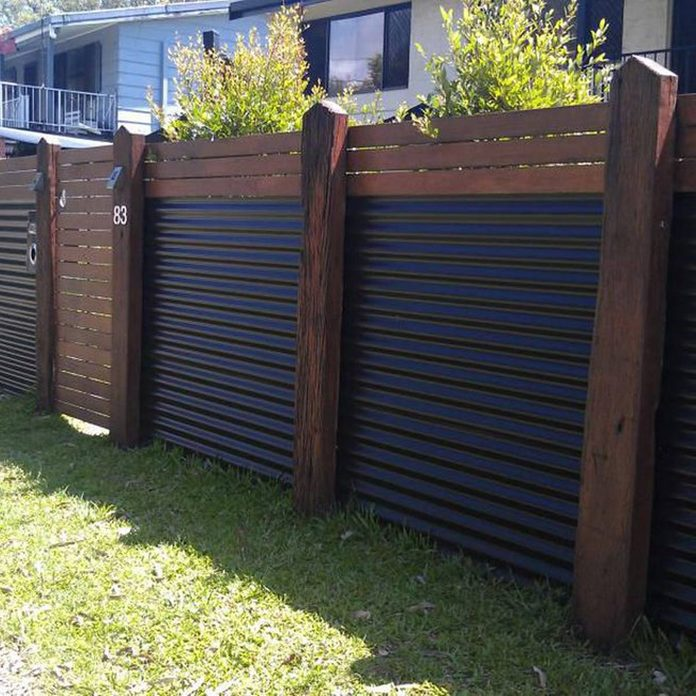 Wood and Corrugated Metal Fence