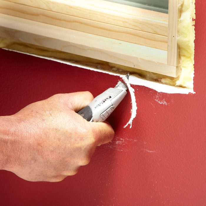 Cutting away drywall for better trim fits   Construction Pro Tips