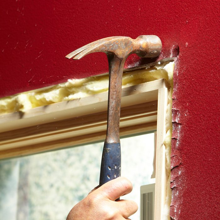 Knocking back projecting drywall with a hammer   Construction Pro Tips