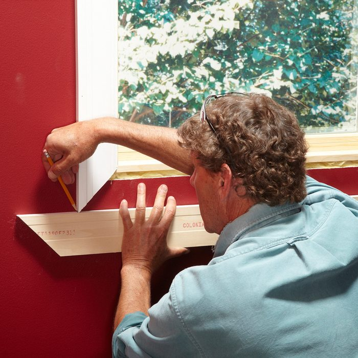 Scribing the miter for a perfect fit   Construction Pro Tips