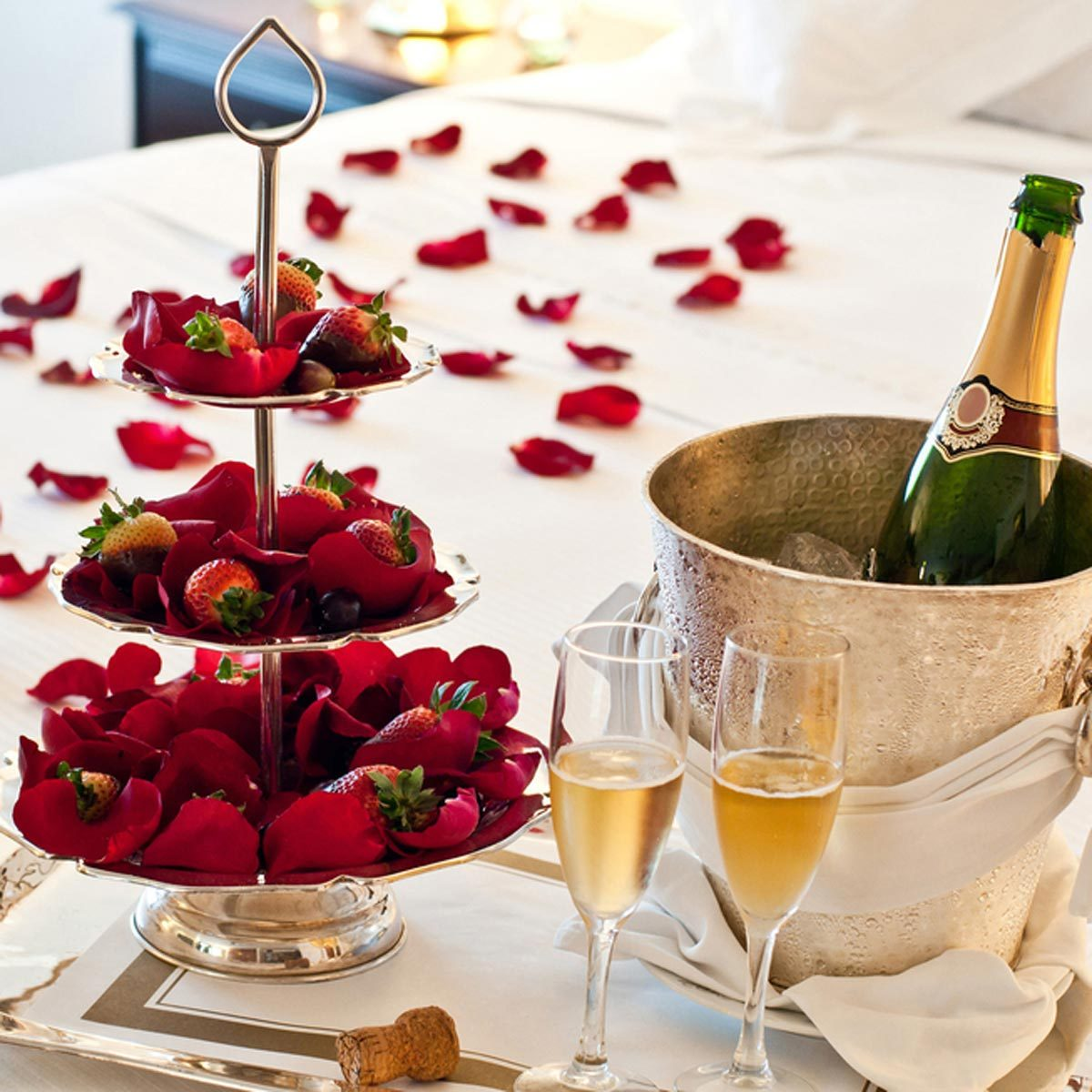 valentines day bedroom rose petals champagne chocolate covered strawberries romantic