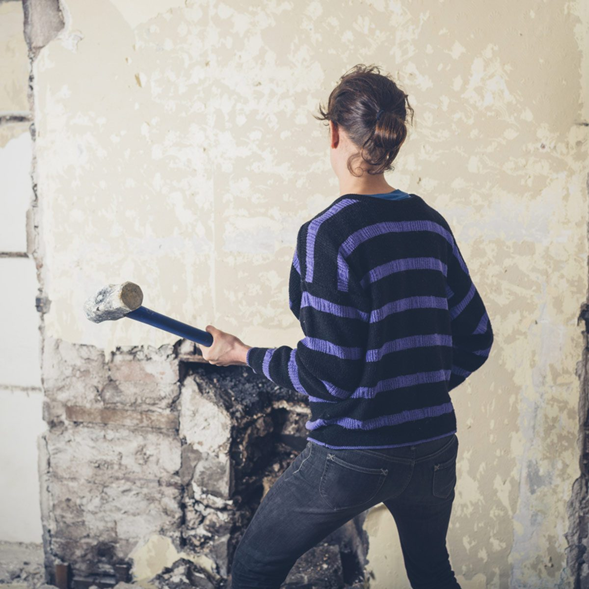 Woman with Sledgehammer Hand Tools for Demolition