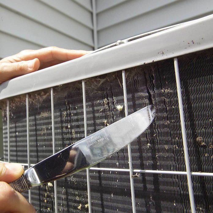 fixing ac fins with butter knife
