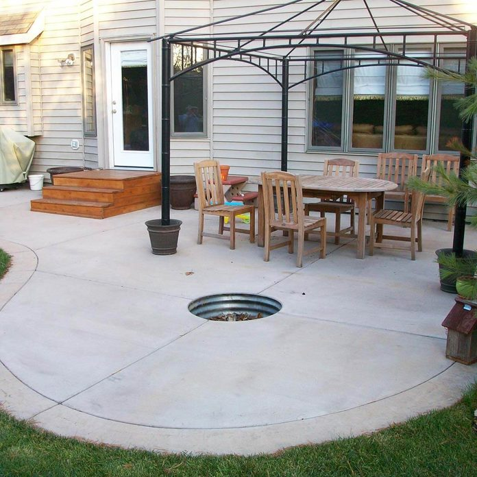 Concrete Patio with Fire Pit small backyard patio
