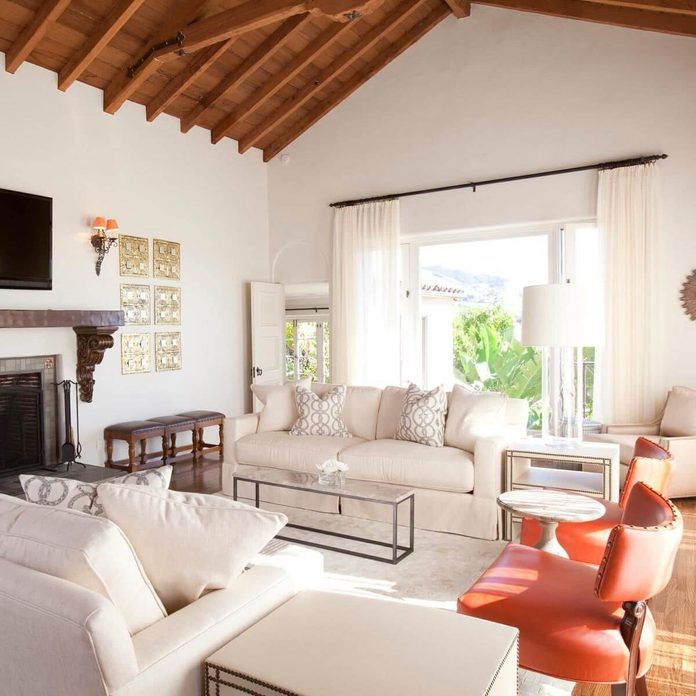 transitional style living room vaulted wood ceilings