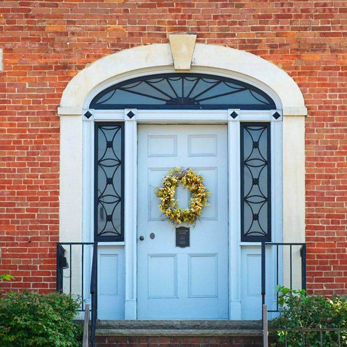 wreath on front door brick home