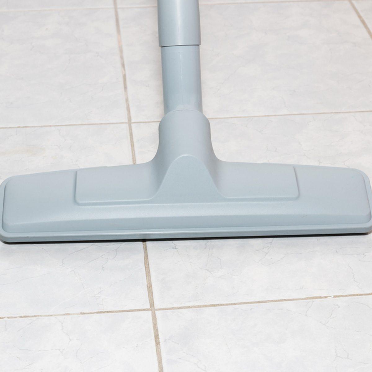 vacuum clean bathroom tile