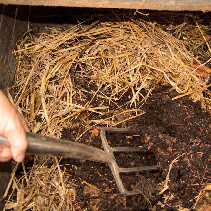 churning compost pile