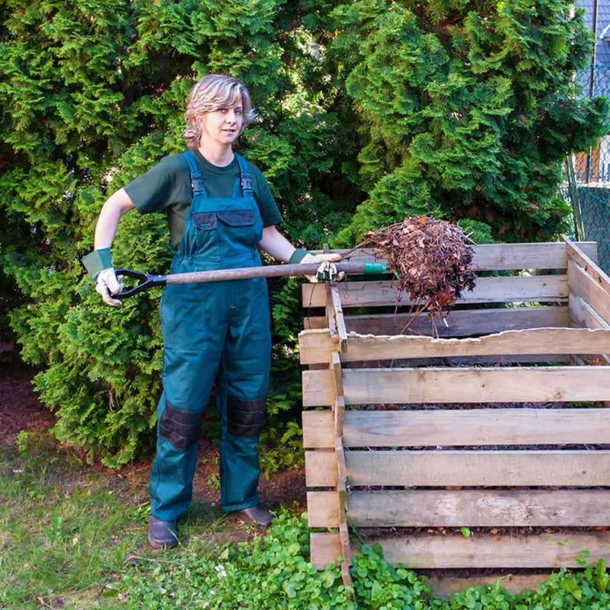 lady scooping compost