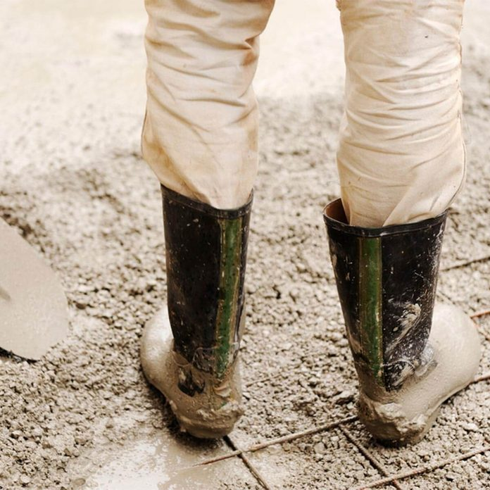 standing in concrete with boots
