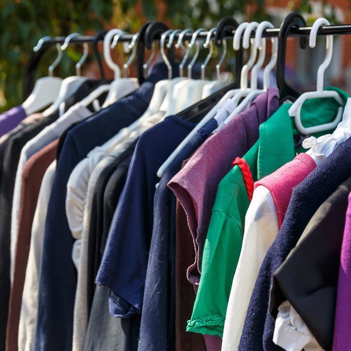 full closet with clothes
