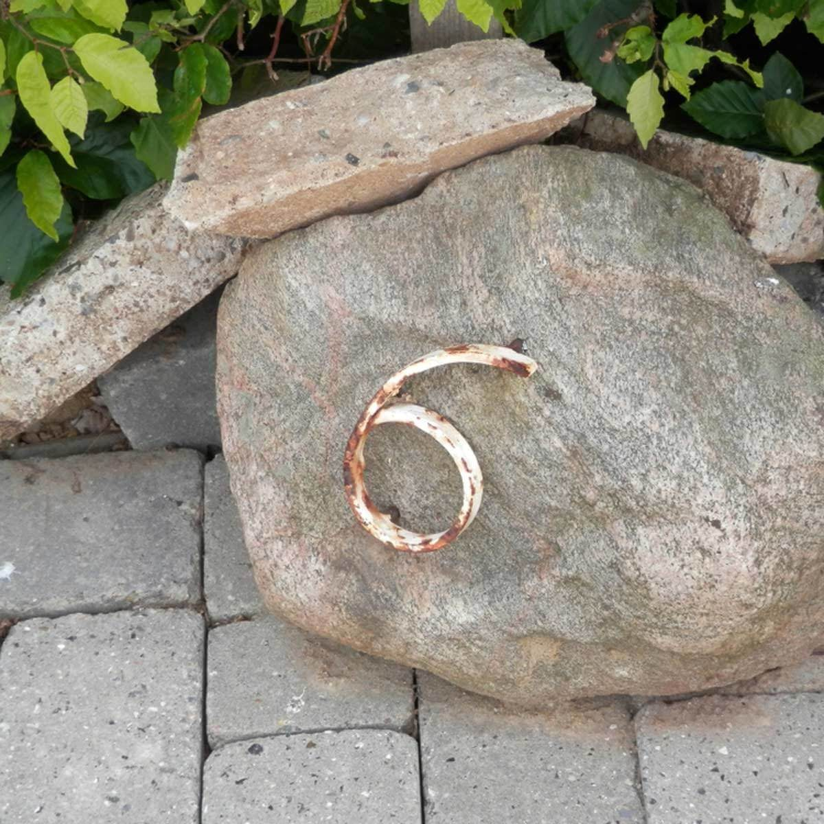 house numbers welded to a rock
