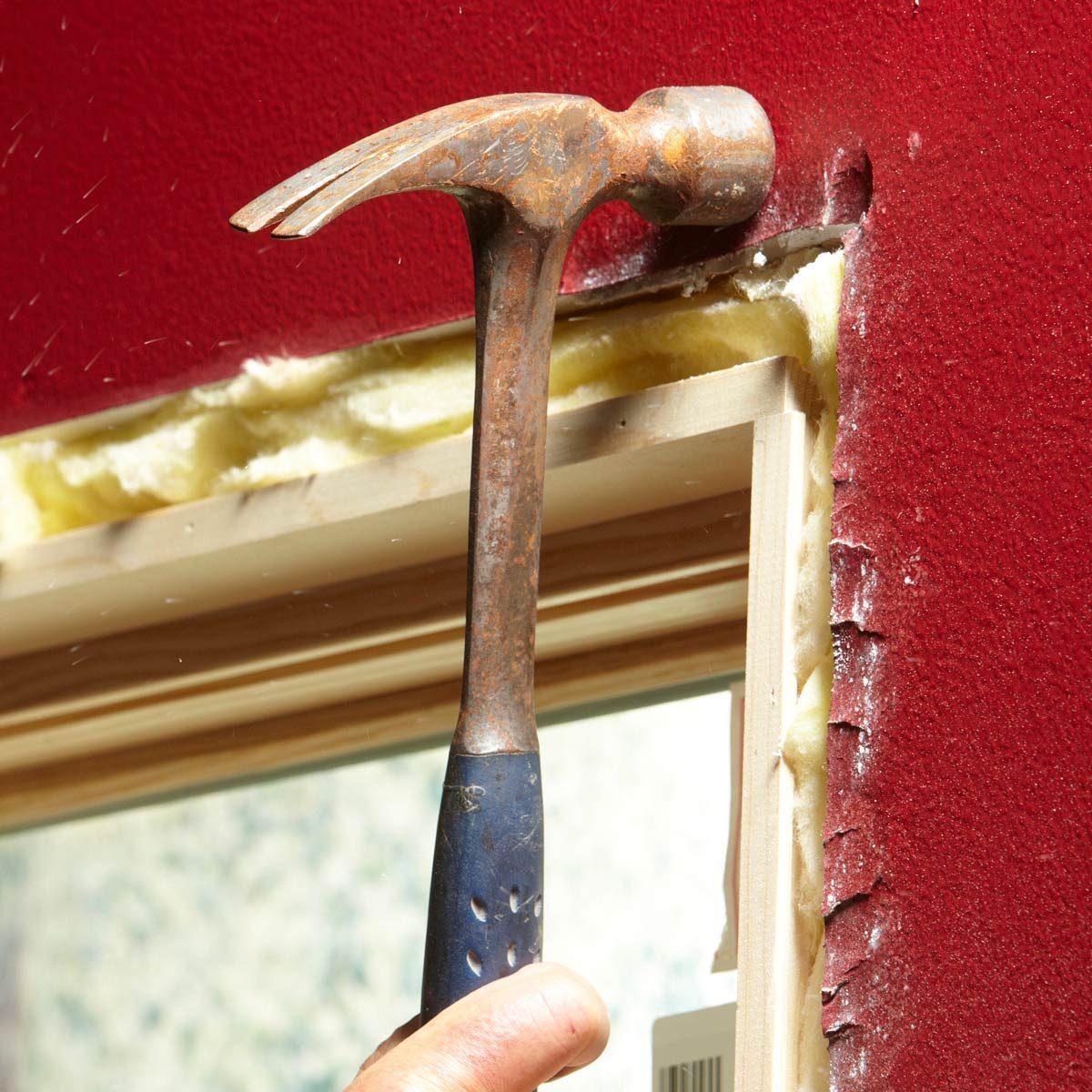 smash drywall around window trim