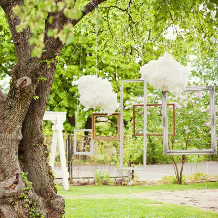DIY wedding photo booth picture frames from trees simple outdoor wedding ideas