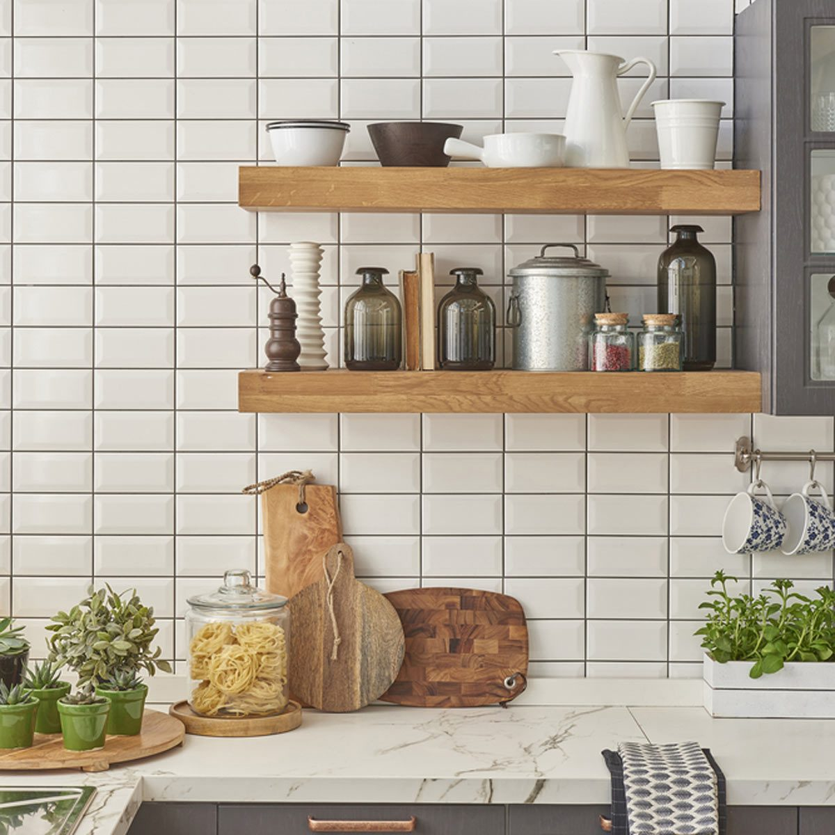 white subway tile in kitchen open shelves