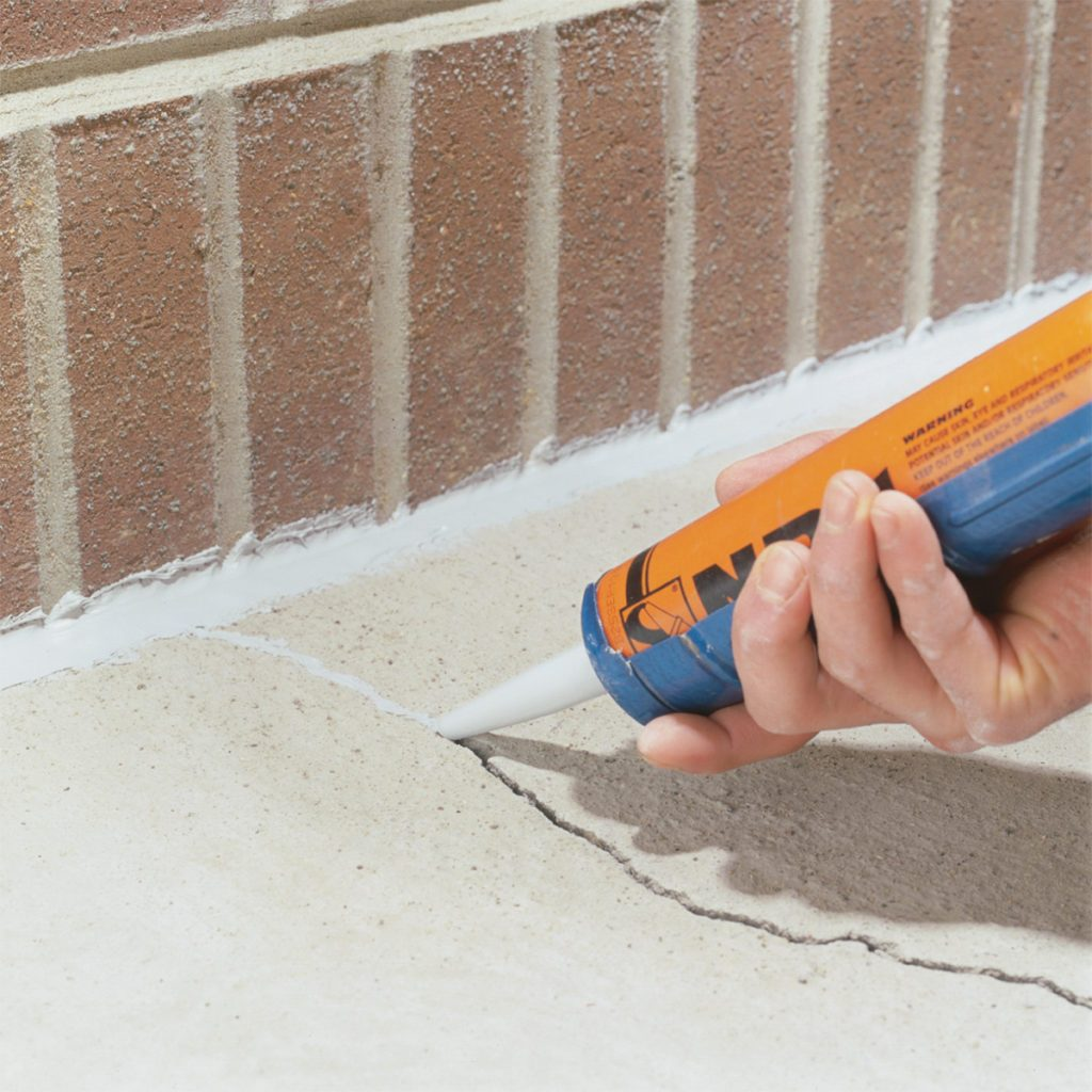 Sealing cracks in concrete with sealant | Construction Pro Tips