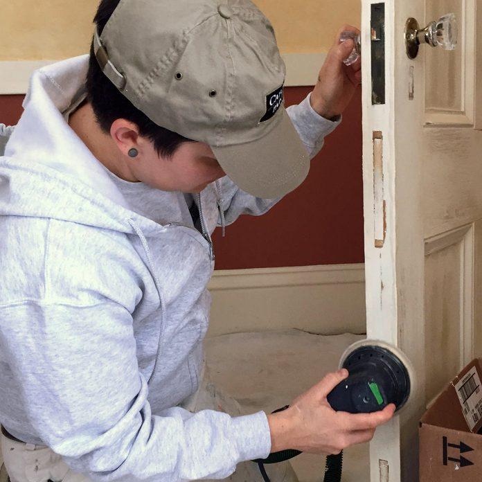 painting sanding door frame
