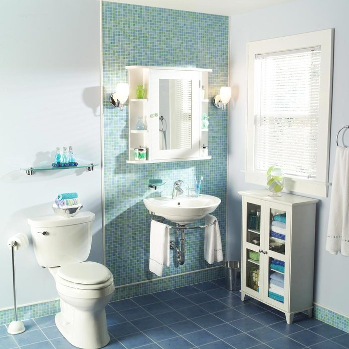 Bathroom makeover after blue teal tile wall