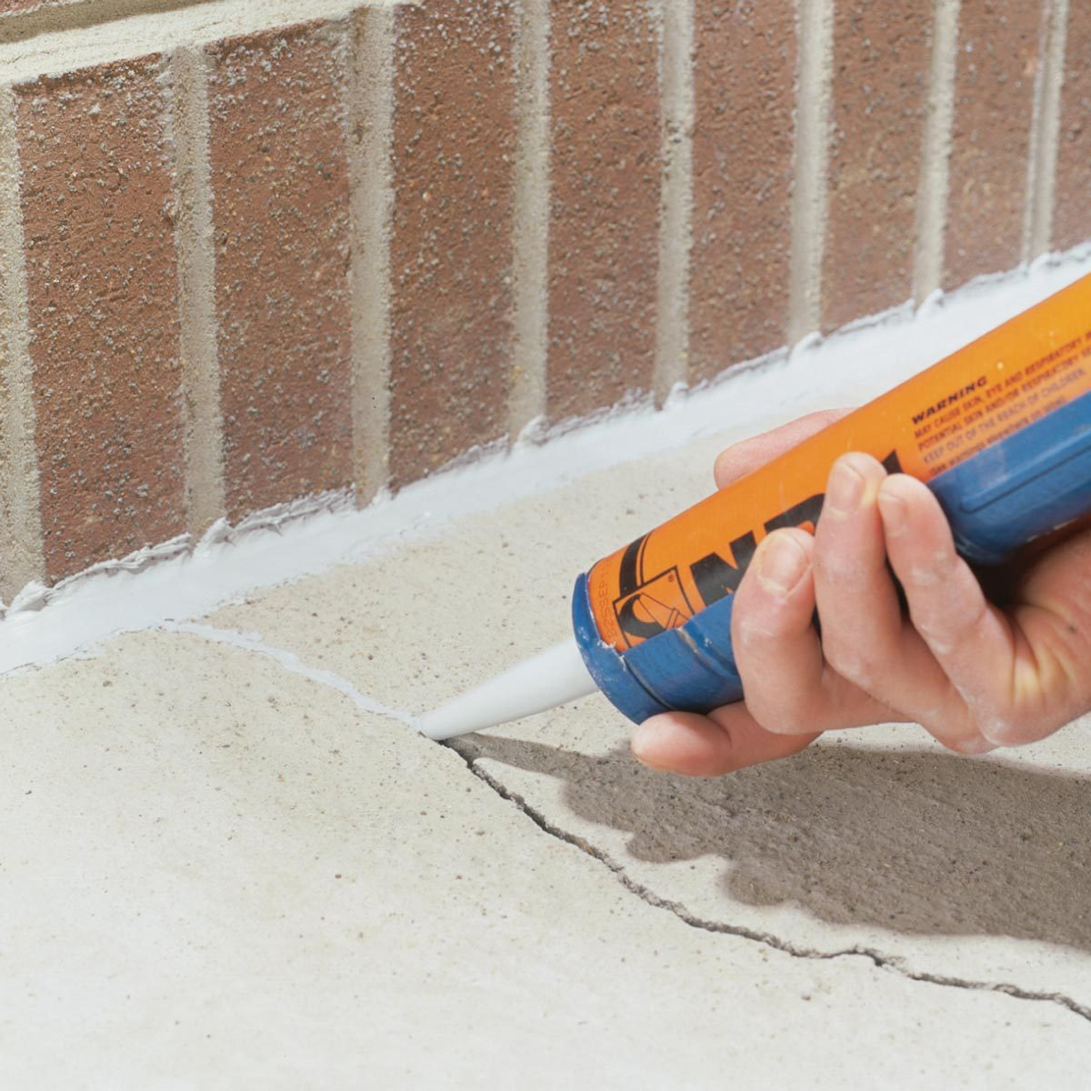 caulk a crack in concrete