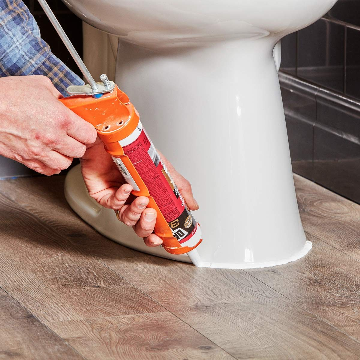 caulk around toilet
