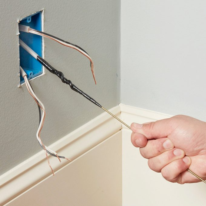 fishing wires through outlet