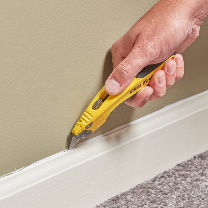 remove base molding with a utility knife
