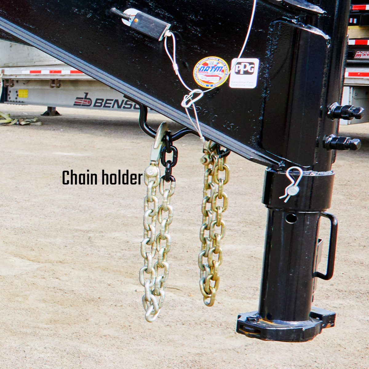 Chain holders under trailer arm | Construction Pro Tips