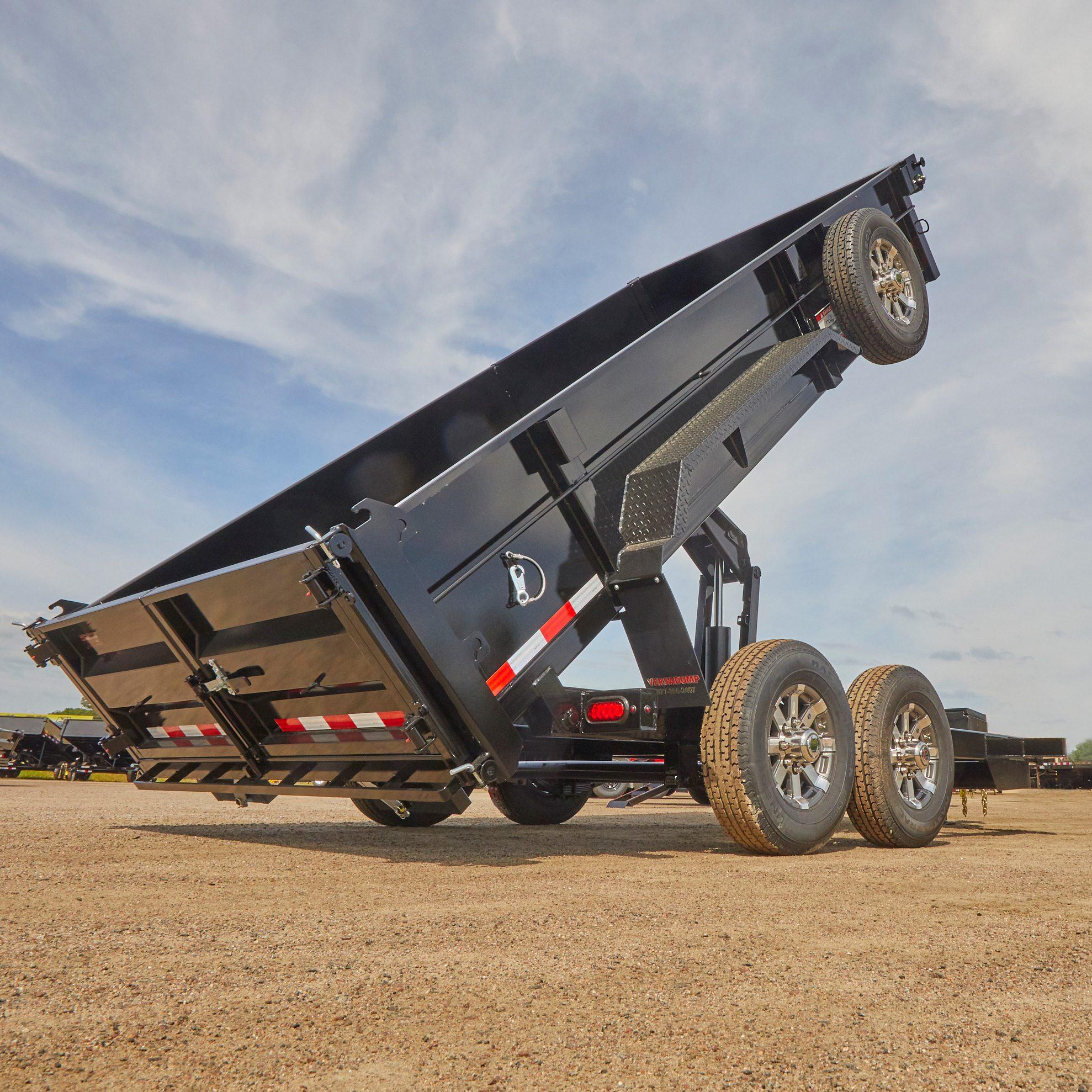 Black Dump Trailer in Dump Position | Construction Pro Tips