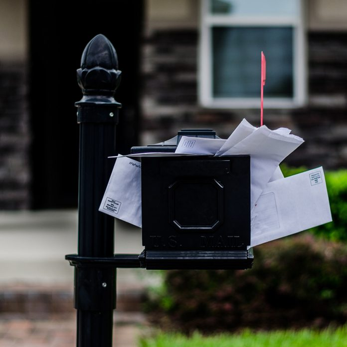 An overflowing mailbox reads like an invitation to burglarize.