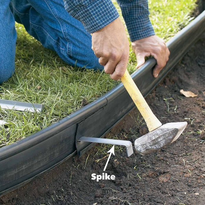 spike path edging to sod
