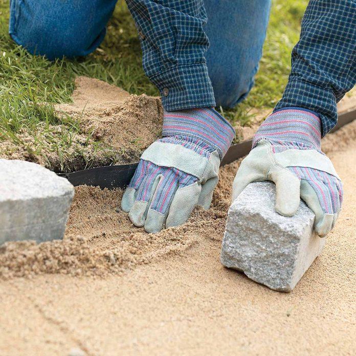 adjust sand to fit cobbles