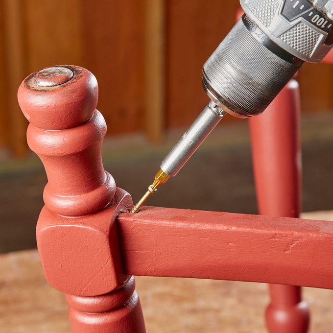 tighten a wobbly chair with trim screws