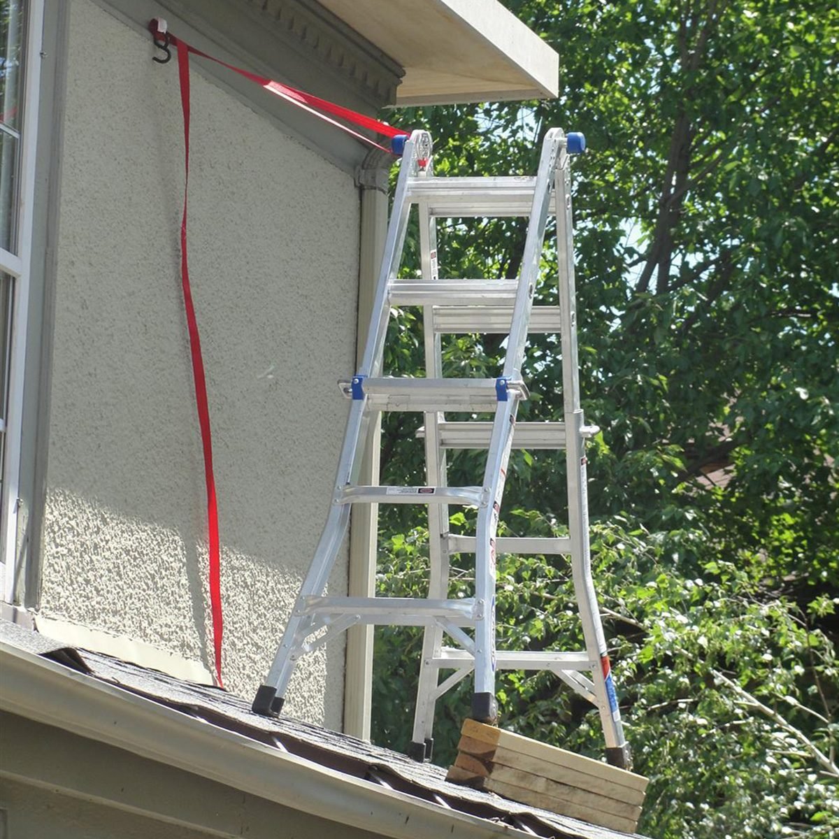 A ladder strapped up to the side of the house | Construction Pro Tips