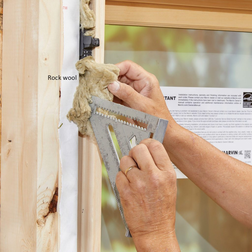 Adding insulation to the side cavity of a window   Construction Pro Tips