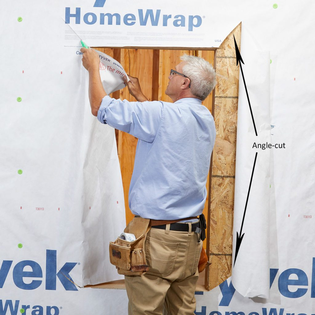 Man cutting angles in the corner of Tyvek   Construction Pro Tips
