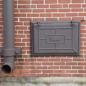 Why Old Homes Have a Tiny Iron Door Leading to the Basement