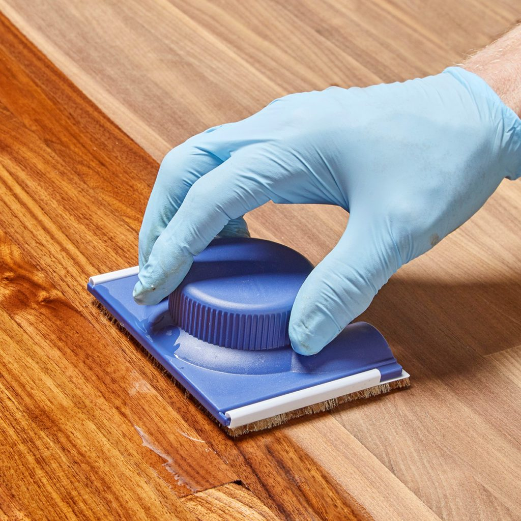 Paint pad spreading poly finish on wood | Construction Pro Tips