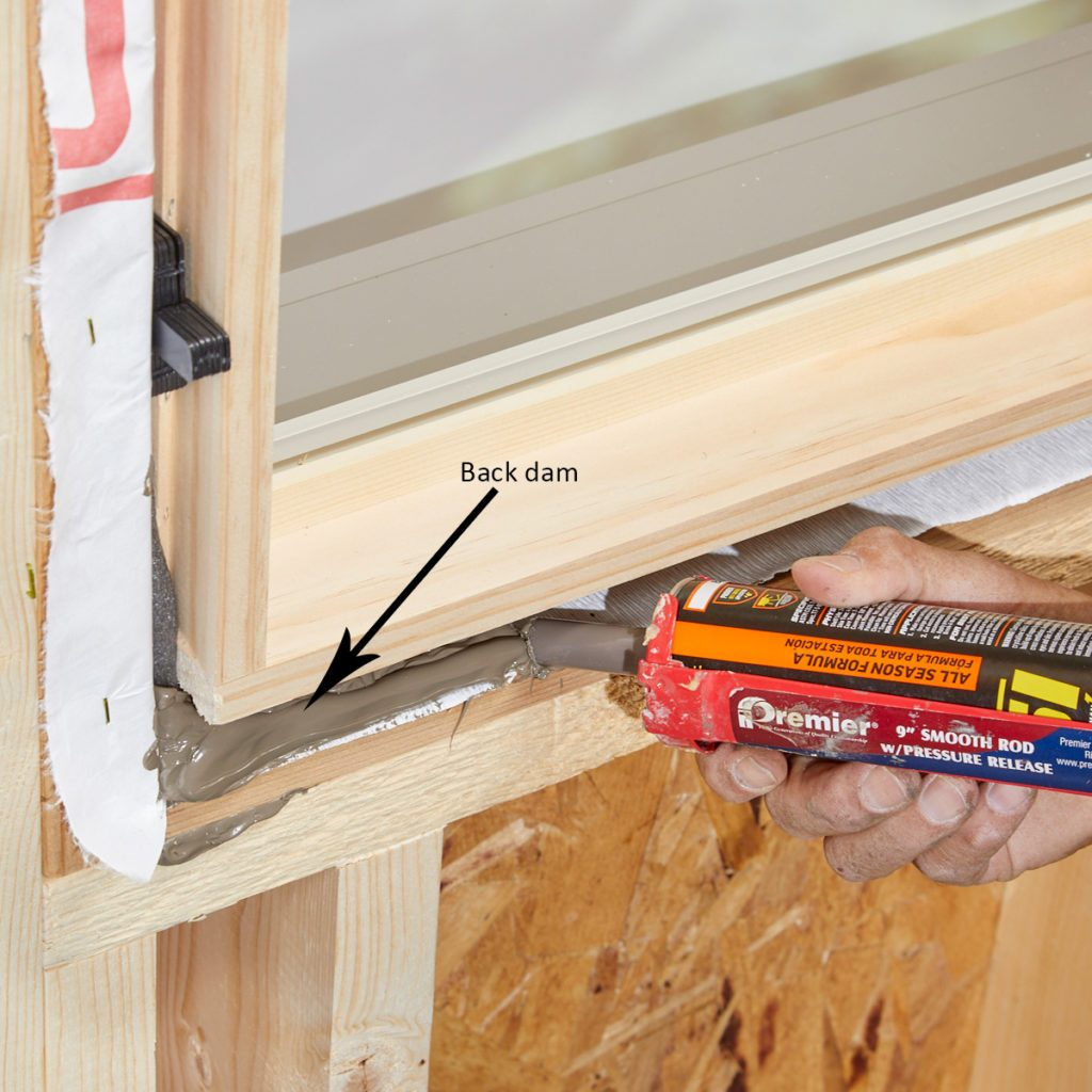 Create a back dam with window sealant   Construction Pro Tips